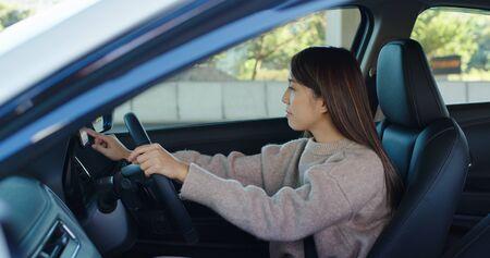Woman set gps location on cellphone inside a car