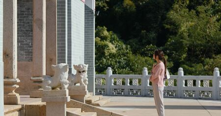 Woman visit chinese temple in Hong Kong