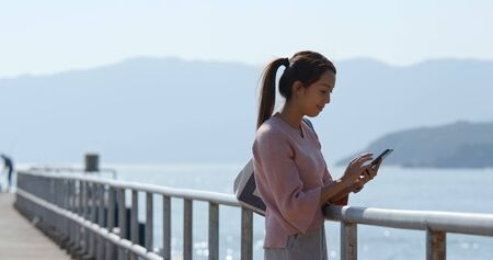 Woman use of mobile phone at outdoor 免版税图像