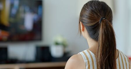 Woman watch tv at home
