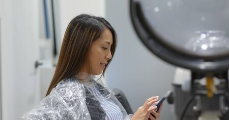 Woman with hair treatment in beauty salon