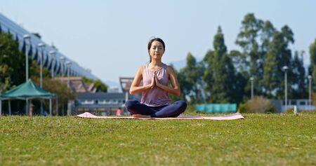 Woman do yoga at park