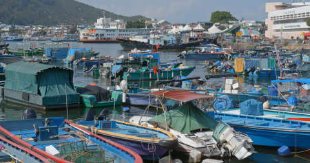 Cheung chau, Hong Kong, 24 April 2019: Crowded of small boat in Cheung chau island at sunset time 新闻类图片