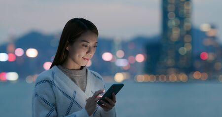 Woman use of cellphone in city at outdoor