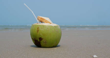 Coconut fresh juice on beach