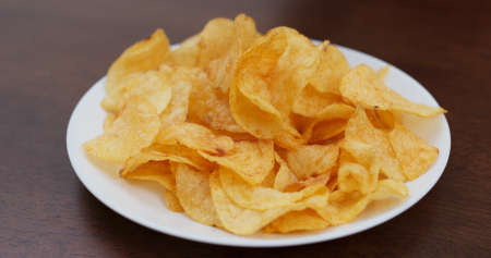 Potato chip on white plate