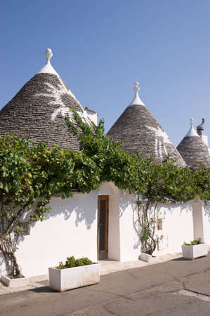 Exterior of traditional trulli houses in Alberobello (Puglia, Italy). These dry-stone houses with conical roofs are characteristic of middle-southern Apulia.