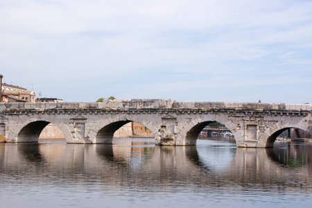 successor: The Bridge of Tiberius in Rimini is a Roman bridge. It features five semicircular arches. Its construction started in 14 AD during Augustus reign and finished under his successor Tiberius in 21 AD. Stock Photo
