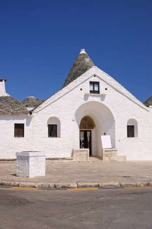 two floors: Trullo Sovrano in Alberobello (Apulia, Italy). This is the only trulli house with two floors built in Alberobello. Stock Photo