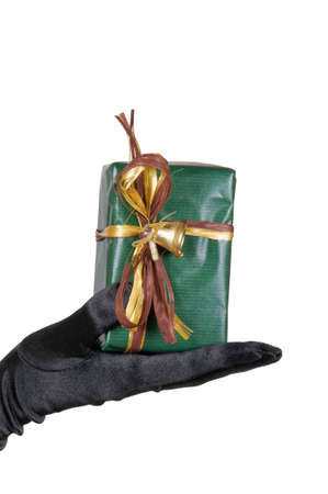 Black gloved female hand holding a present photo