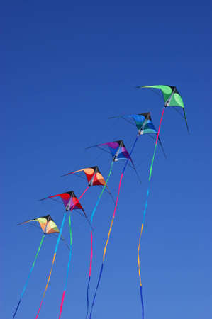 Kites against a vivid blue sky