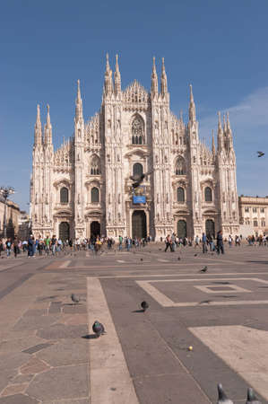 Gothic facade of Milan cathedral in Piazza del Duomo. Built during six centuries (from 14th to 20th century) it is the fourth largest church in the world Stock Photo - 9588842