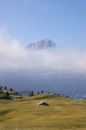 raiser: Langkofel (Sassolungo in Italian, Saslonch in Ladin) view from Col Raiser in a misty morning. This mountain range is part of the Dolomites and divides the Fascia valley (Val di Fassa in Italian, Val de Fascia in Ladin, Fassatal in German) from Val Gardena