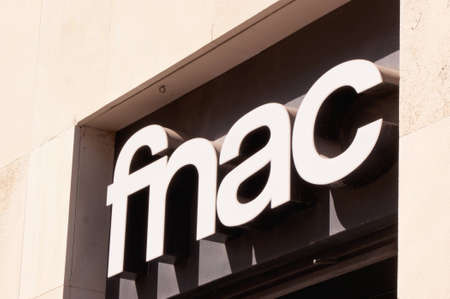 Fnac neon shop sign in Seville. The acronym Fnac stands for Fédération Nationale d'Achats des Cadres. This retail chain was founded by by André Essel and Max Théret  in 1954 and is the largest electronic and cultural retailer in France. Editorial