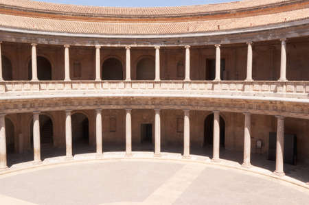 carl: Circular patio of the palace of Charles V in Granada. The construction of this palace inside the Alhambra was decided by the Holy Roman Emperor Carl V in 1526. It was built in Roman style and the construction was abandoned in 1637, leaving the roof unfini