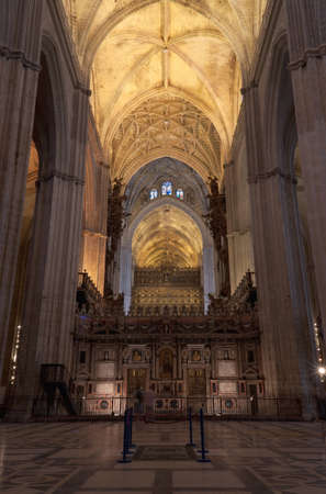 church interior: Interior of Seville Cathedral. Built between 1402 and 1506, Seville Cathedral is the largest gothic church in the world.