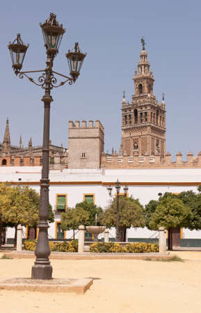 View of the Giralda tower from the Patio de Banderas in the Real Alcazeres, in Sevilla (Spain) Editorial