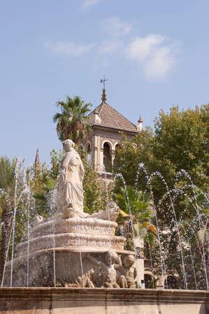 The fountain of Seville (Fuente de Sevilla) in Puerta de Jerez square. The fountain was designed by Manuel Delgado Brackembury in 1929 for the Ibero-American Exposition World Editorial