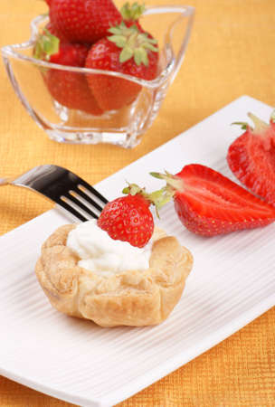 Mini strawberry tart on a white plate