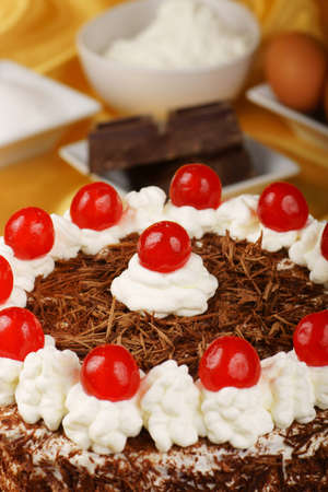 Close-up of a Schwarzwaelder Kirschtorte  Black Forest cake  with the ingredients out of focus in the background