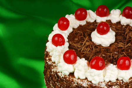 Close-up of a Schwarzwaelder Kirschtorte  Black Forest cake , one of the most famous German cakes  It consists of a chocolate cake, filled and decorated with whipped cream, maraschino cherries and chocolate  The name of the cake comes from Schwarzwaelder  Stock Photo