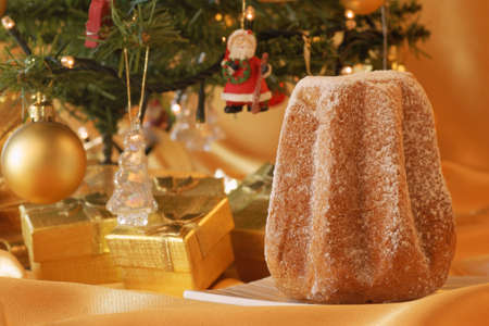 Christmas composition  Pandoro, a typical italian Christmas cake, and Christmas decorations photo