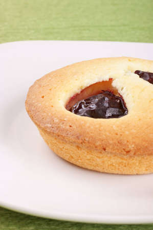 Close-up of a plum cake served on a white plate  Selective focus