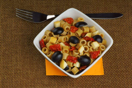 Summer pasta salad served in a white bowl                                 Stock Photo