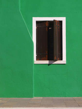 Window on a green wall in Venice                                Stock Photo