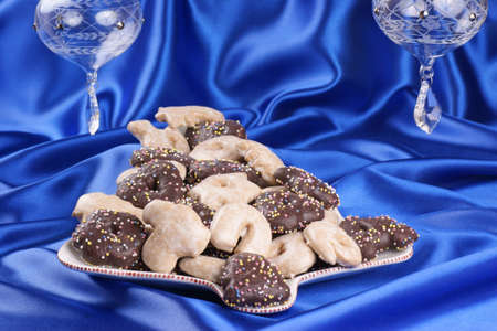 Blue Christmas composition  gingerbread Christmas cookies served on a Christmas tree shaped plate