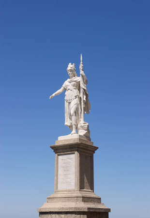 The Statue of Liberty in San Marino against a vivid blue sky  The statue, built in white marble of Carrara, was donated by Otilia Heyroth Wagener, countess of Aquaviva, in 1876  Stock Photo