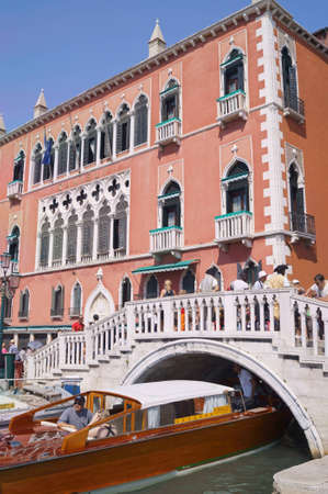 Tourists walking in front of  Palazzo Dandolo, one of the most famous palaces overlooking the  Riva degli Schiavoni   This building forms now the Hotel Royal Danieli   Editorial