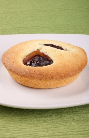 Small plum cake on a white plate  Selective focus, shallow DOF