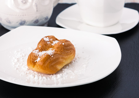 choux bun: choux pastry on a white plate