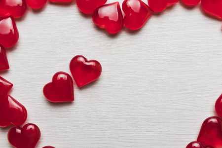 background of red hearts on a white wooden substrate Stock Photo