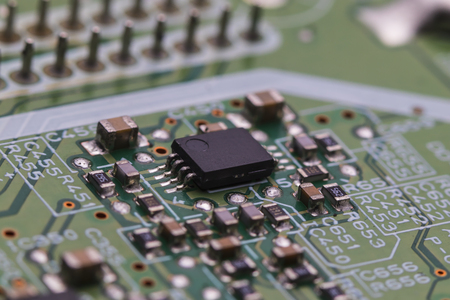 printed circuit Board with chips and radio components electronics Stock Photo