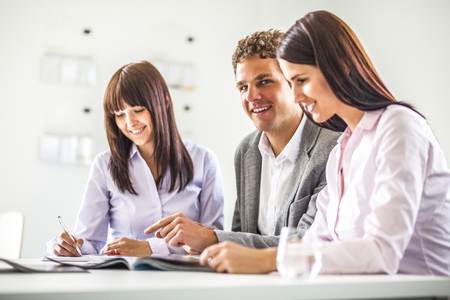 Young businessman having discussion with female colleagues in creative office Reklamní fotografie