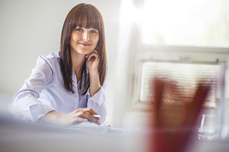 Portrait of beautiful young businesswoman working in office