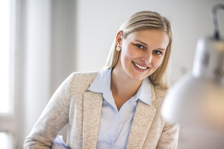Portrait of young businesswoman smiling in office