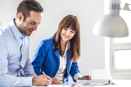 Young businesswoman with male colleague working together in office Reklamní fotografie