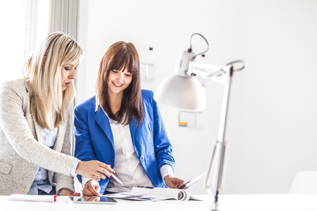 Young businesswomen discussing together in office