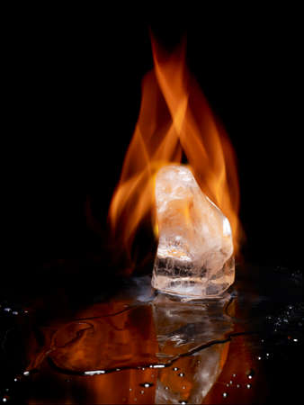 Grain of ice wrapped in flames