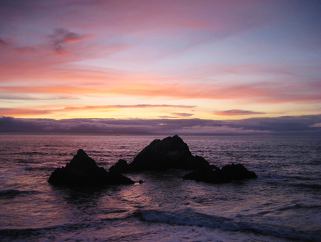 Spectacular sunset at Point Lobos looking out at Seal Rocks, San Francisco Stock Photo