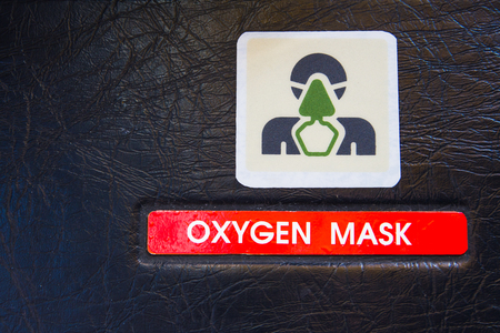 Oxygen mask warning label in an Airbus A320 cockpit. Used in emergency cases for supplying emergency oxygen supply. Stock Photo