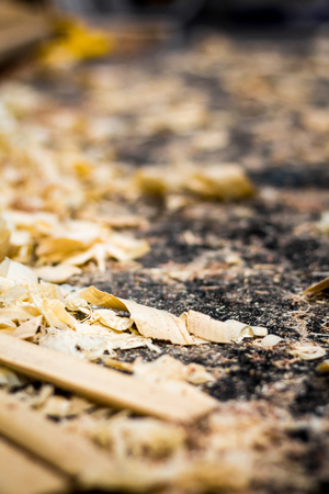 shavings of wood and sawdust on the floor of a carpenters workshop