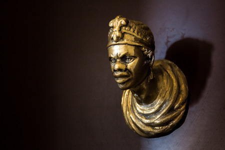 Door knob in the shape of the face of an African man. Venice, Italy. Stock Photo