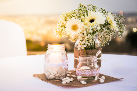 Pretty White Wedding Table Decorations With Flowers Candles