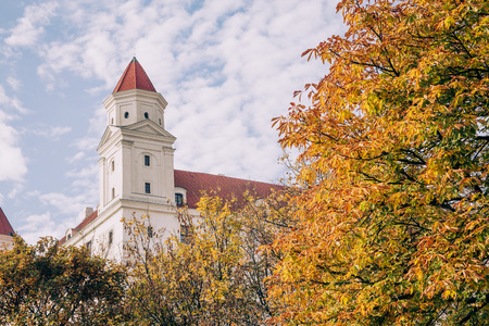 Bratislava castle framed by trees in autumn. Editorial