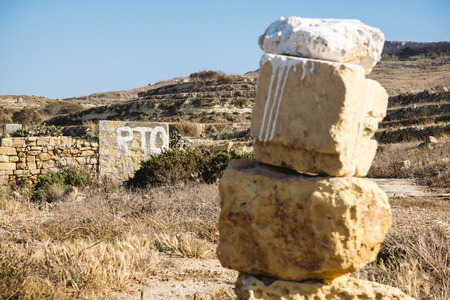 Painted sign indicating supposedly private land in Malta, Gozo. RTO painted in white on a rural building. Stock Photo