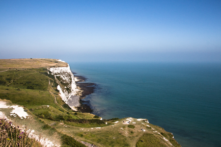 The white cliffs of Dover on a sunny blue sky day.